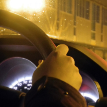 Hand Gripping the Steering Wheel
