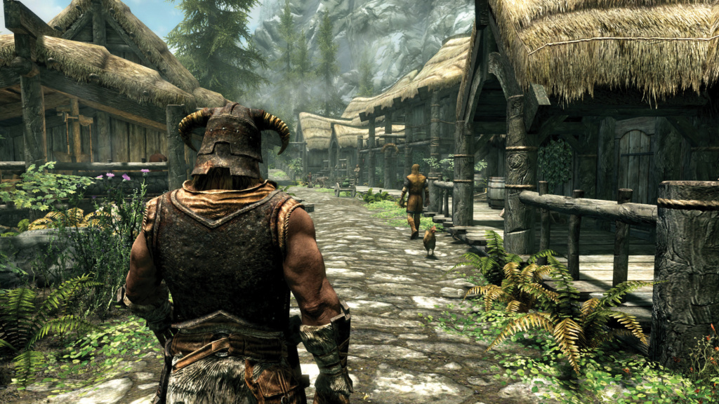 Caption: Shot of a player in what appears to be Riverwood. Photo obtained from official Skyrim site.